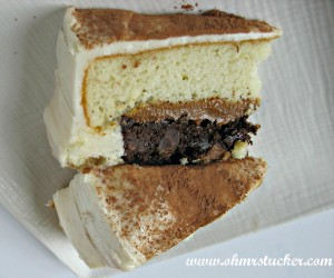 slice of cake with bottom brownie layer