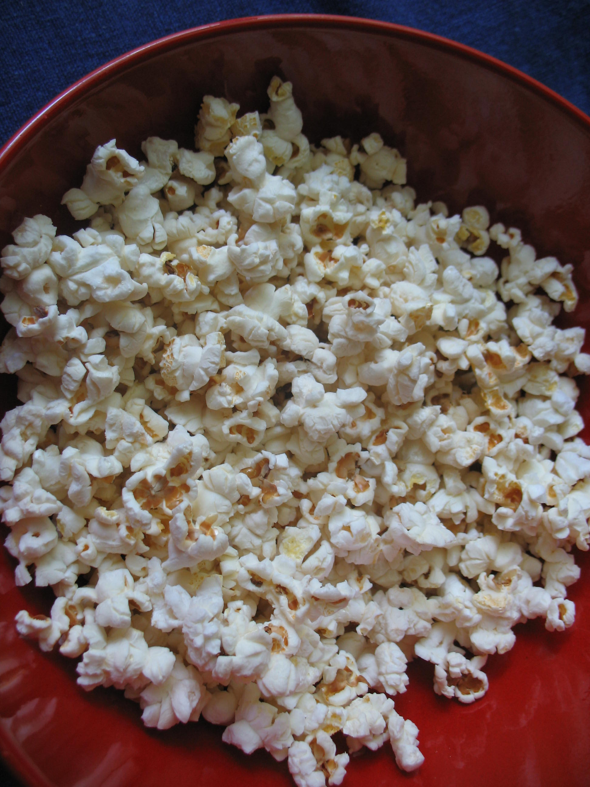 popcorn in red bowl