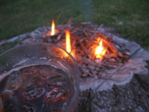 DIY Firepit with small fire with a glass with fluid