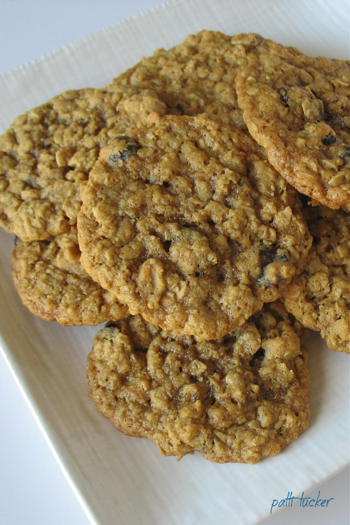 stack of Perfect Oatmeal Cookies on white plate