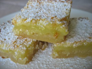 stacked cut leman bars dusted with powder sugar
