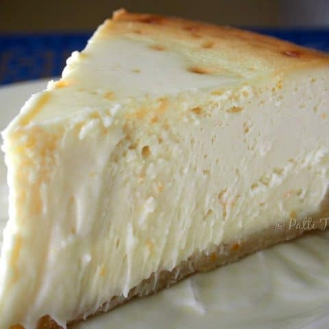 a closeup of a slice of cheesecake on a plate