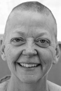 smiling woman with bald head
