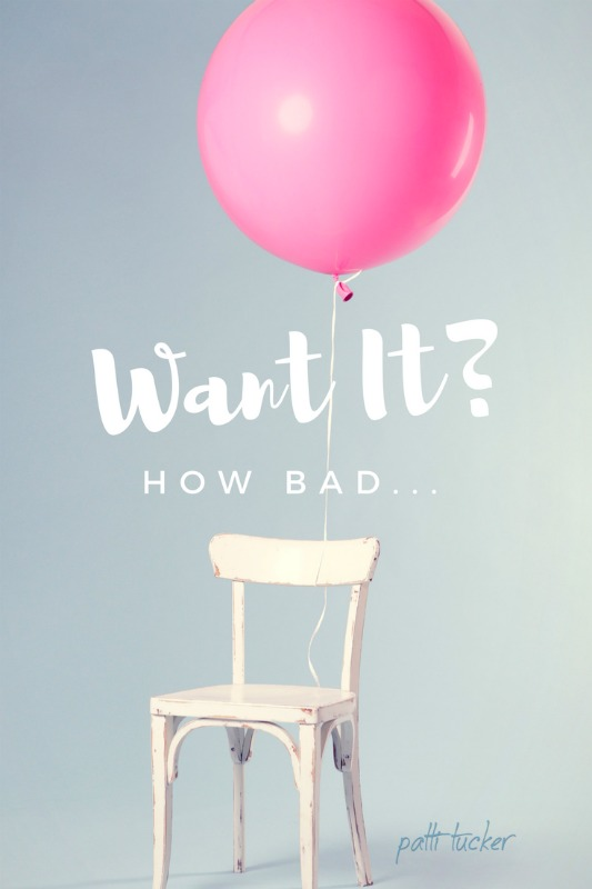 text graphic: how bad do you want it with a boif pink balloon tied to white chair