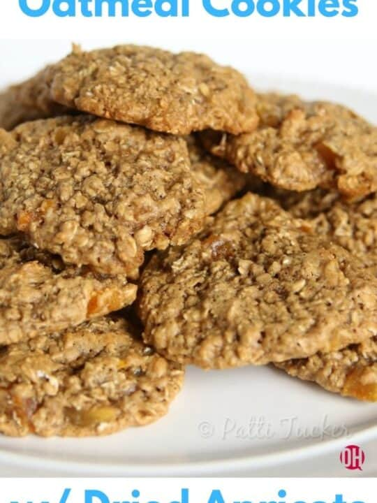 oatmeal cookies stacked on a white plate