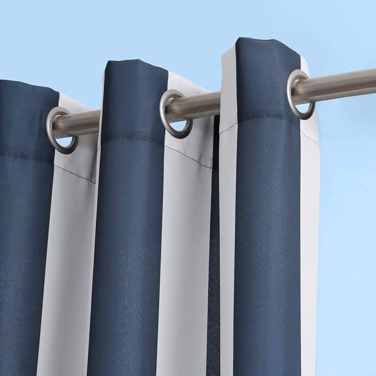 Blue striped outdoor curtain hung on rod