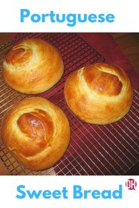 Three loaves of Portuguese Sweet Bread cooling on a wire rack