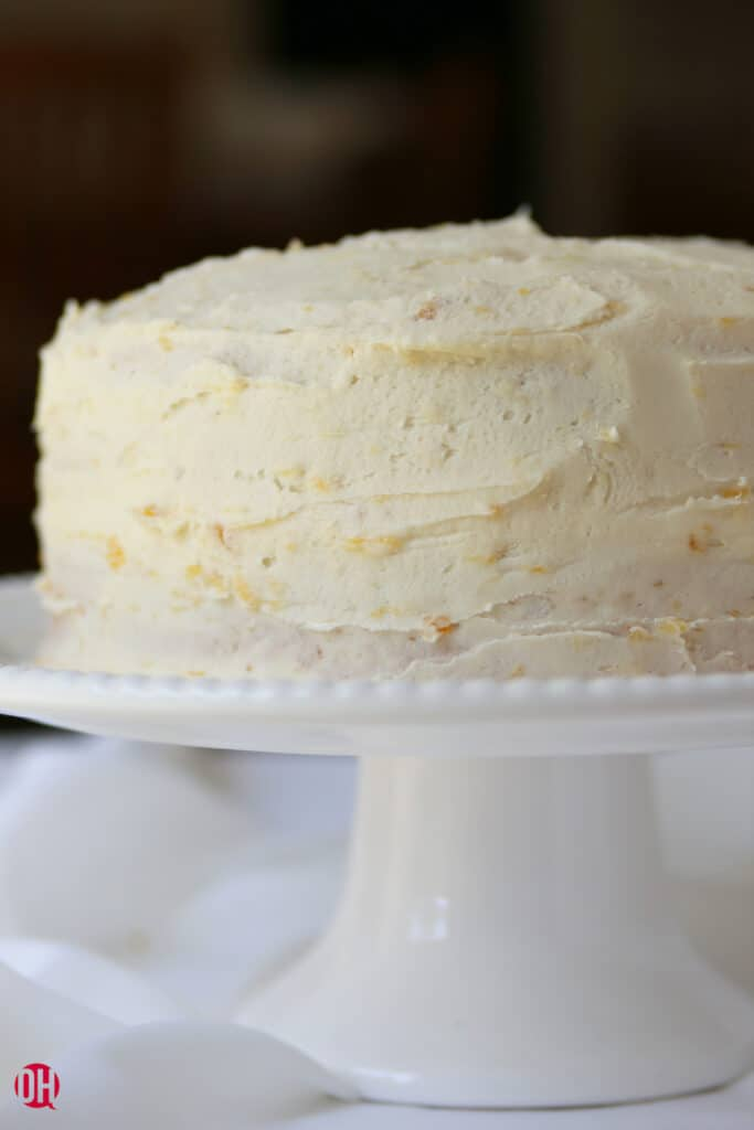 white frosted cake on cake pedestal
