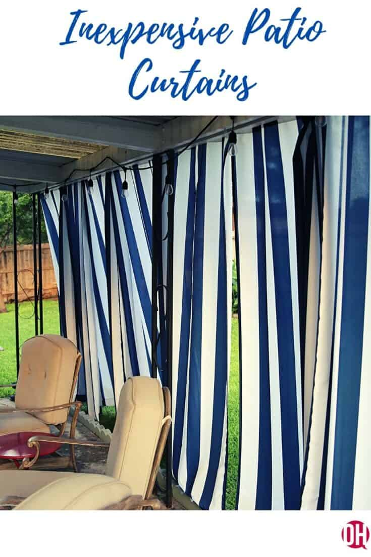 Stripped patio curtain behind patio furniture