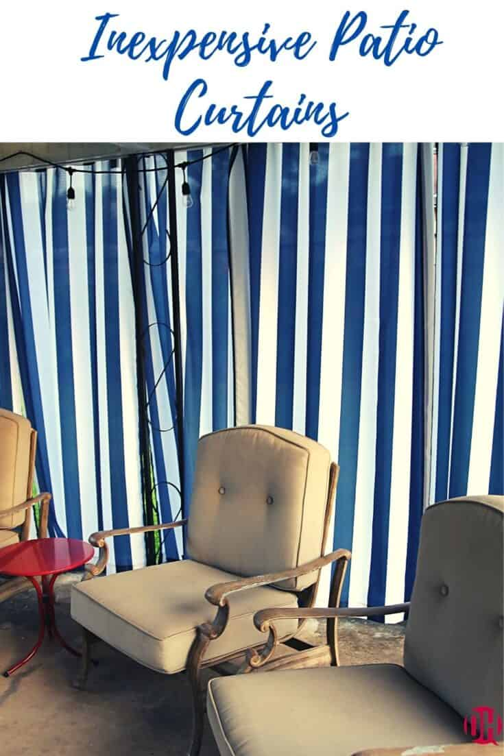 Blue striped patio curtains behind patio chairs.
